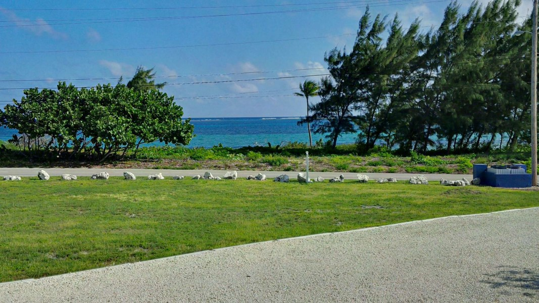 RE/MAX real estate, Cayman Islands, Colliers, Investment Property in East End - -Two Apartments plus Land for Future Development