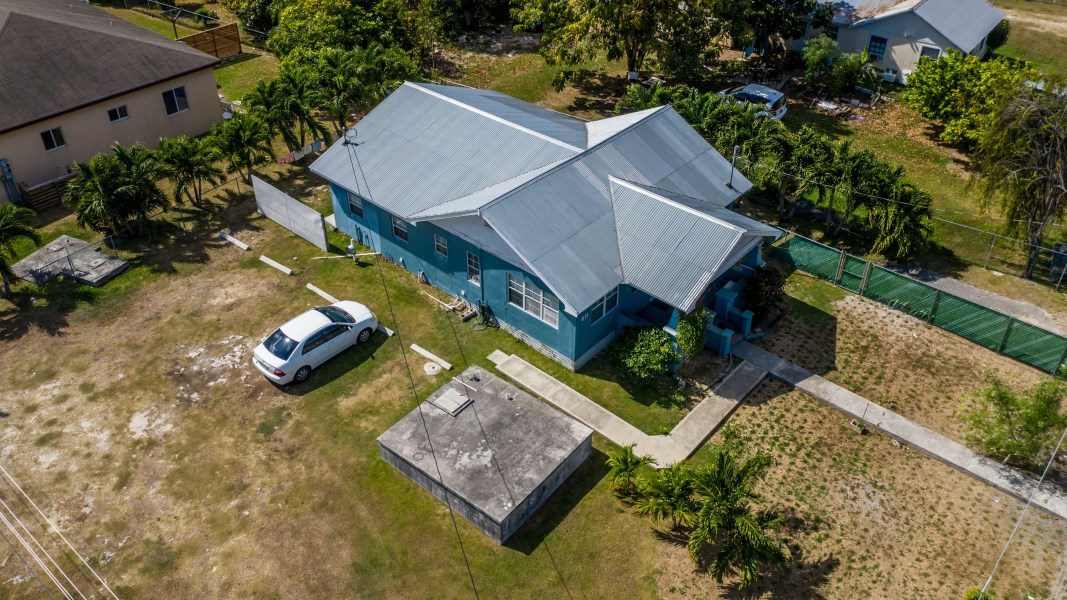 RE/MAX real estate, Cayman Islands, W Bay Bch West, Lovely Two Bed Home in West Bay with One Bed/One Bath Income Apt., on Corner Lot