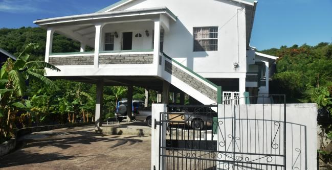 RE/MAX real estate, Grenada, Golflands, This cozy three bedroom and two bathrooms home is located in the developing neighborhood of the Golf Course, St George's.
