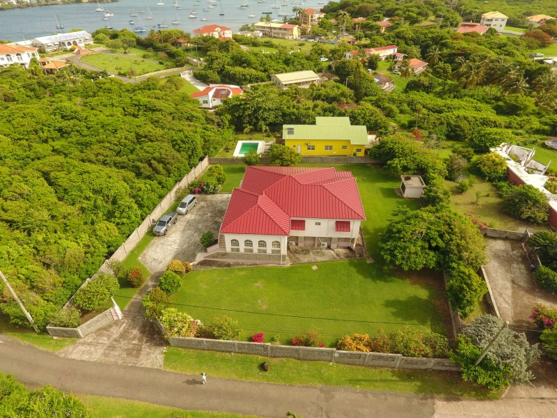 RE/MAX real estate, Grenada, Lance aux Epines, Impressive home on flat user-friendly grounds located at the prestigious Lance aux Epines neighbourhood.