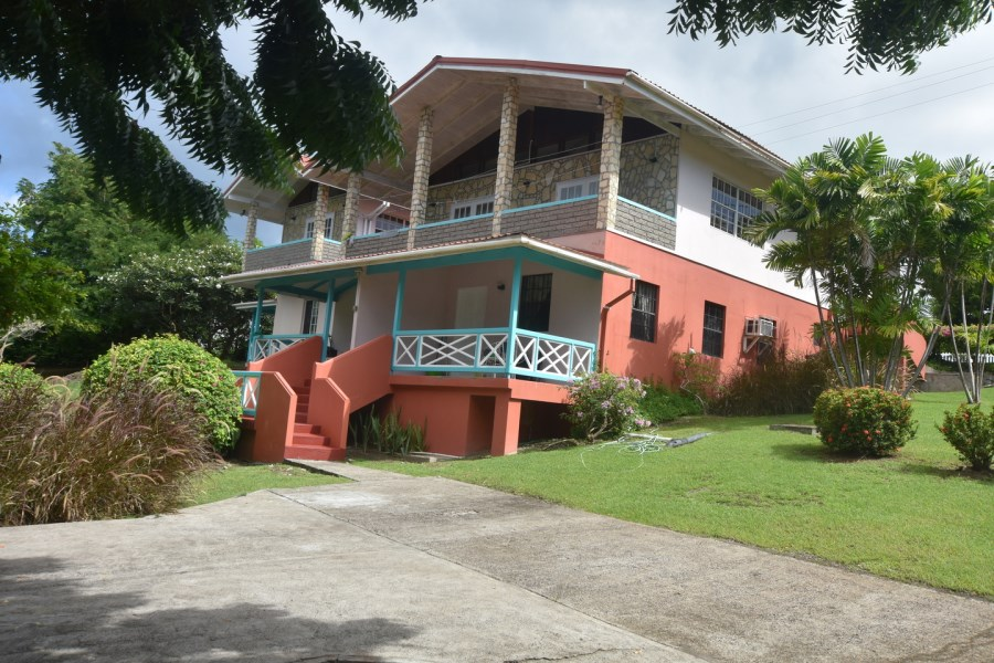RE/MAX real estate, Grenada, Lance aux Epines, Well-appointed two-story residential property located at a prominent corner position at Lance Aux Epines, St George.