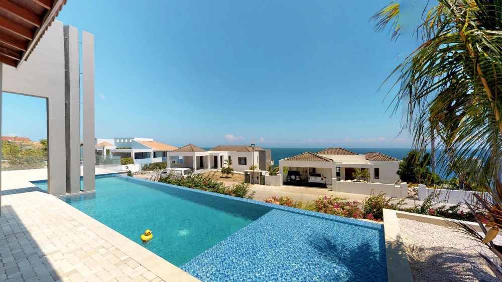 RE/MAX real estate, Curacao, Blue Bay, Blue Bay Resort -New house for sale in gated community with ocean view