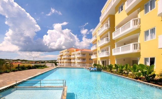 RE/MAX real estate, Curacao, Blue Bay, Furnished 1-bed condo on 4th floor -gated community with private beach