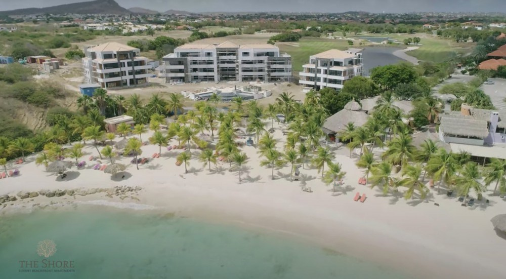 RE/MAX real estate, Curacao, Blue Bay, New luxury corner beach apartment with pool on beach -Blue Bay Resort