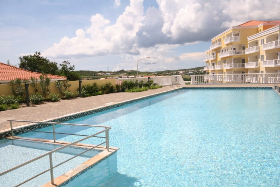 RE/MAX real estate, Curacao, Blue Bay Golf & Beach Resort, Triple Tree 27- furnished 2 bedroom condo with pool, beach & golf