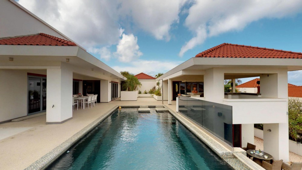 RE/MAX real estate, Curacao, Blue Bay Golf & Beach Resort, Blue Bay Resort: Mansion with guest studios, ocean views and two pools