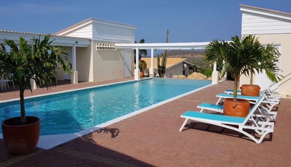 RE/MAX real estate, Curacao, Santa Catharina, St. Catharina Resort 26 - brand new house on gated resort with pool!