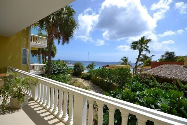 RE/MAX real estate, Curacao, Blue Bay Golf & Beach Resort, Stunning 2 Bedroom Blue Bay Condo With Garden, Beach and Ocean Views!