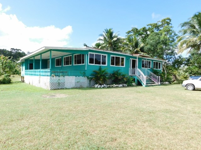 RE/MAX real estate, Belize, Belmopan, #2141 - 10 ACRES + BUILDING LOCATED ON A MAIN HIGHWAY IN BELMOPAN CITY