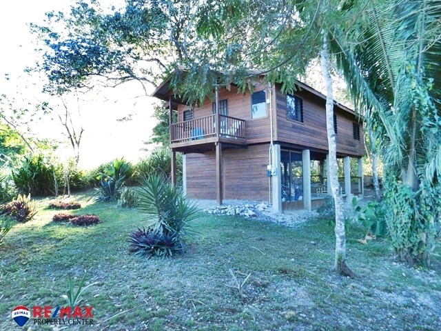 Remax real estate, Belize, San Ignacio, # 8000 - BELIZEAN HARDWOOD ONE BEDROOM HOUSE FOR SALE ON 0.21 ACRES OF LAND – SAN IGNACIO TOWN, CAYO DISTRICT