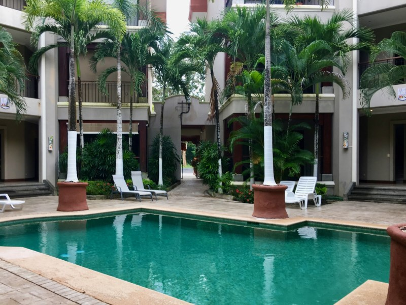 Remax real estate, Costa Rica, Jaco, Condo is surrounded by lush tropical landscaping and a guard at the entrance adds to the comfort and security.