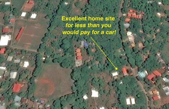Remax real estate, Honduras, Utila, Crums Hill  by baseball fieldCaribbean land less than car