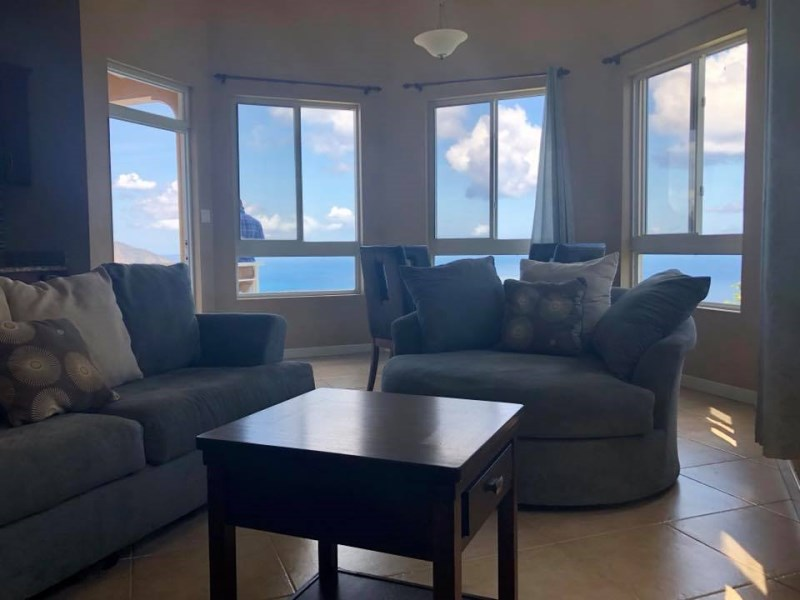 RE/MAX real estate, British Virgin Islands, Cane Garden Bay, **rented until May 19** Modern spacious two bedrooms two bathrooms apartment to rent in Luck Hill.