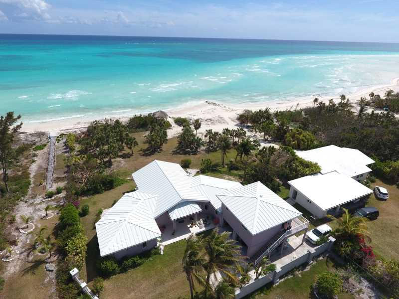 RE/MAX real estate, Bahamas, East End, BEACHFRONT - A TWO BEDROOM VILLA- A  2 BR COTTAGE AND A ONE BEDROOM APT.