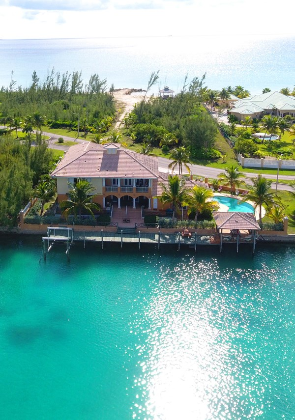 RE/MAX real estate, Bahamas, Princess Isle, FOUR BEDROOM ON THE WATERFRONT WITH VACANT BEACHFRONT LOT