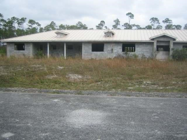 RE/MAX real estate, Bahamas, Freeport, INCOMPLETE TRI COLONY BAY