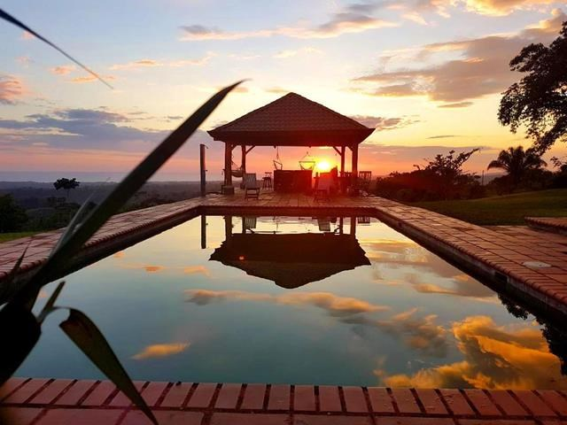 Remax real estate, Costa Rica, Parrita, Panoramic ocean view with amazing sunsets! Large property with two houses for sale between Jacó and Manuel Antonio