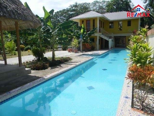 RE/MAX real estate, Belize, Bullet Tree Falls, #2034 - RIVERSIDE HOUSE AND RENTAL CABINS WITH A POOL IN BULLET TREE VILLAGE, CAYO DISTRICT.