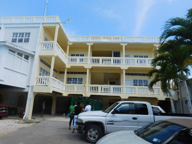 RE/MAX real estate, Belize, Belize City, (#2052) - A 14 ROOM APARTMENT BUILDING LOCATED IN BELIZE CITY.