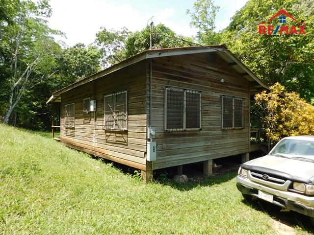 RE/MAX real estate, Belize, Cristo Rey, #2069 - ONE BEDROOM HOUSE WITH 8 ACRES OF LAND WITH A CREEK NEAR CRISTO REY VILAGE, CAYO DISTRICT.