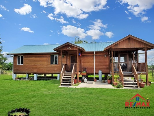 RE/MAX real estate, Belize, San Ignacio, #4046 - Belizean Hardwood Two Bedroom Home with Room for Gardening - San Ignacio Town