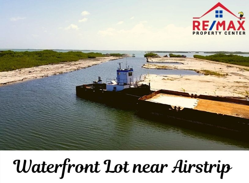 RE/MAX real estate, Belize, Placencia, #7063 - Placencia Waterfront Lot in Exclusive Development near Local Airport