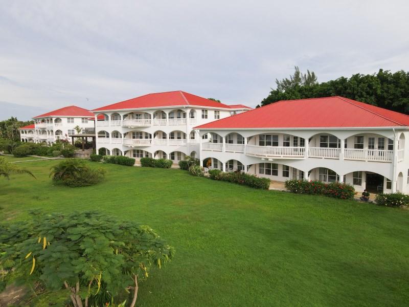 RE/MAX real estate, Belize, Maya Beach, 2 Bedroom Waterfront Condo at Umaya Resort – Owner Financing Available