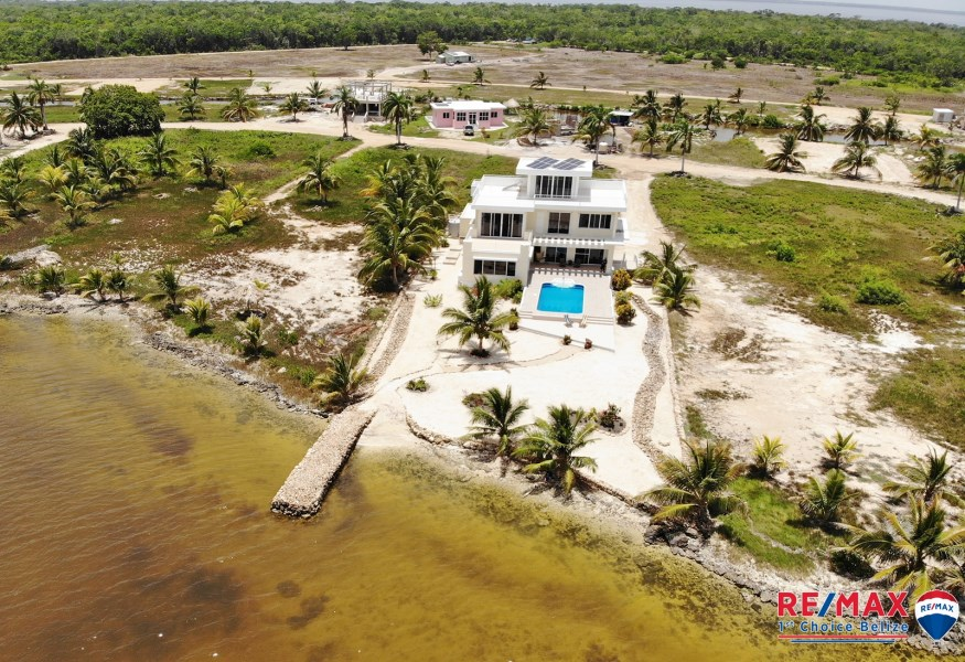 RE/MAX real estate, Belize, Corozal, SUEÑO CARIBE - A TRULY CARIBBEAN DREAM HOME - WATER FRONT LUXURY HOME - MOVE IN SALE – COROZAL, BELIZE