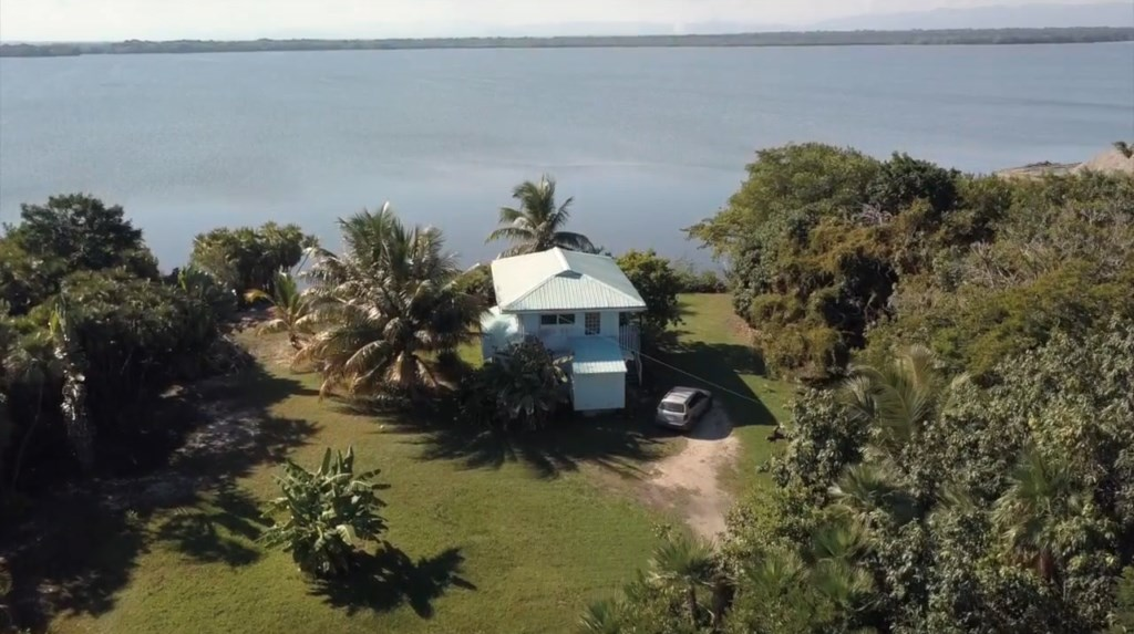 RE/MAX real estate, Belize, Placencia, Private Lagoonfront Home on Double Lot