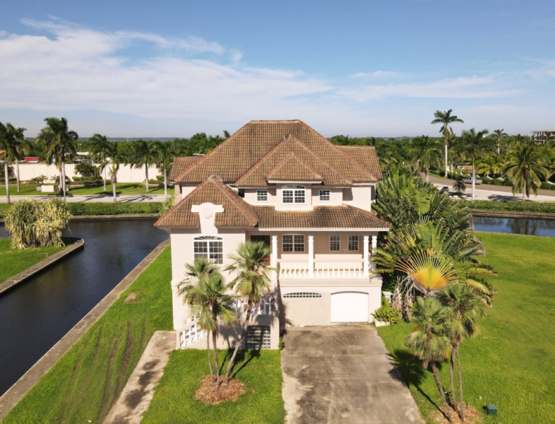 Remax real estate, Belize, Placencia, Stunning One of a Kind Water Front Home in Placencia Residences