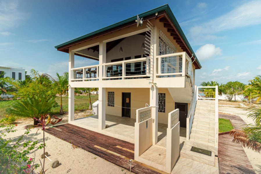 RE/MAX real estate, Belize, Maya Beach, 2 Bedroom Beach Front Home with Pool and Pier