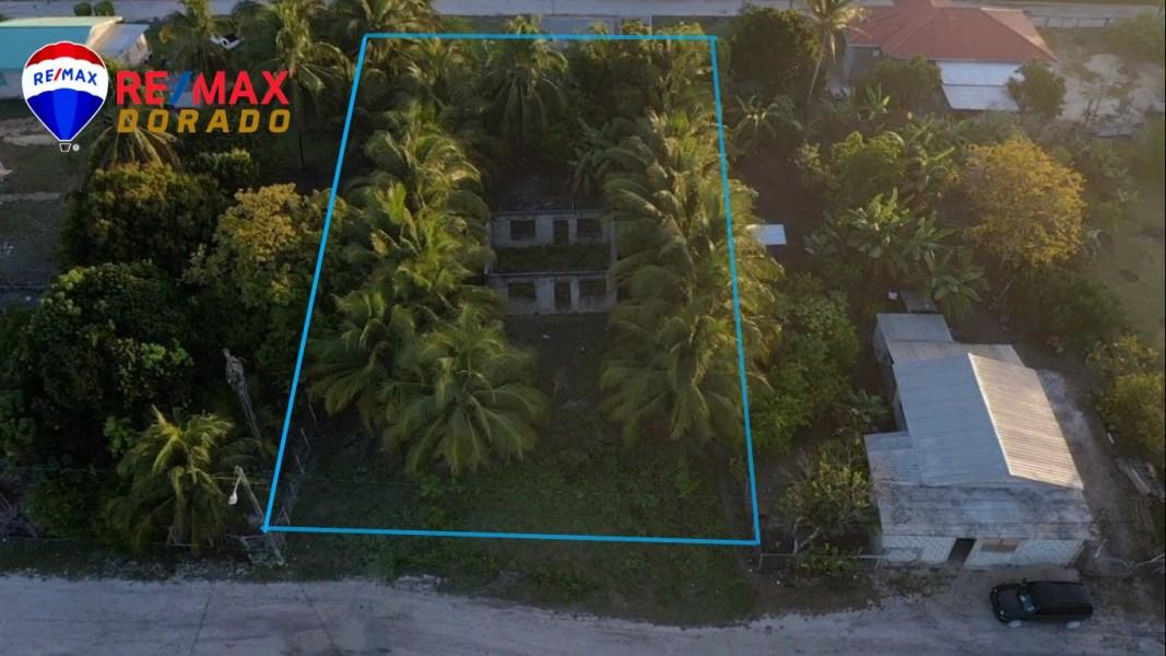 RE/MAX real estate, Belize, San Estevan, Land with an unfinished residential home at San Estevan Village, Orange Walk District, Belize, Central America.