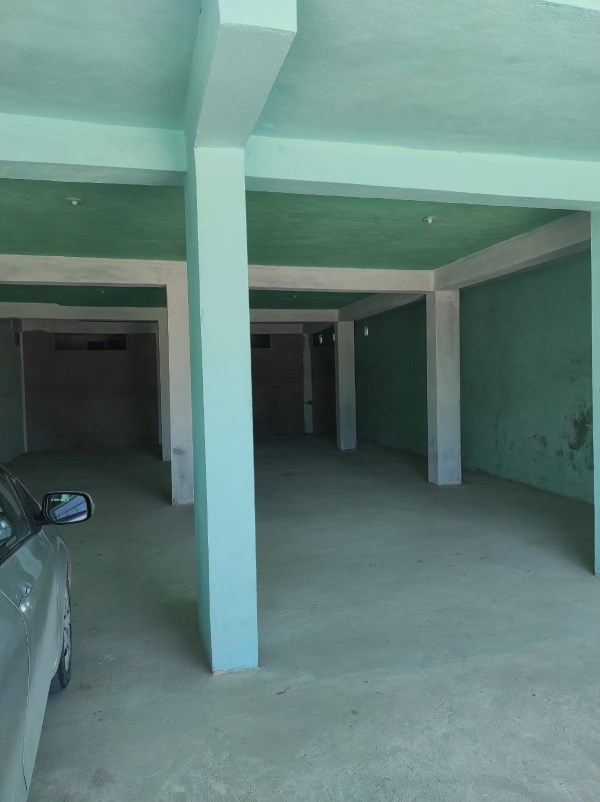 RE/MAX real estate, Belize, Corozal Town, Newly Built Commercial Building and 14 Unit Apartment Complex