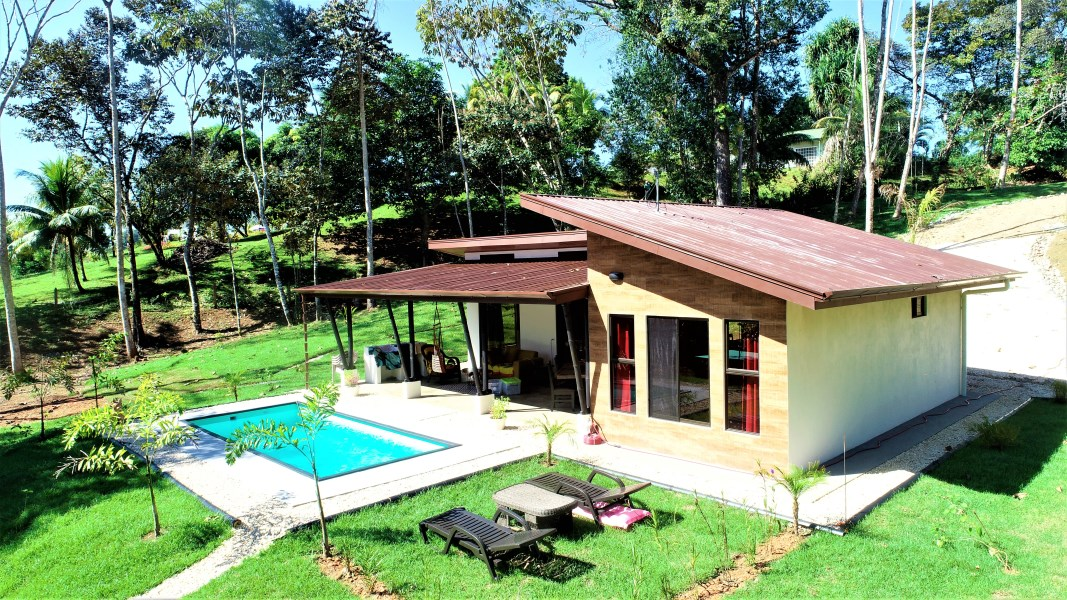 Remax real estate, Costa Rica, Ojochal, SPRING IS A NEW BEGINNING...Begin here with this fantastic NEW HOME on 4 acres with a river too!
